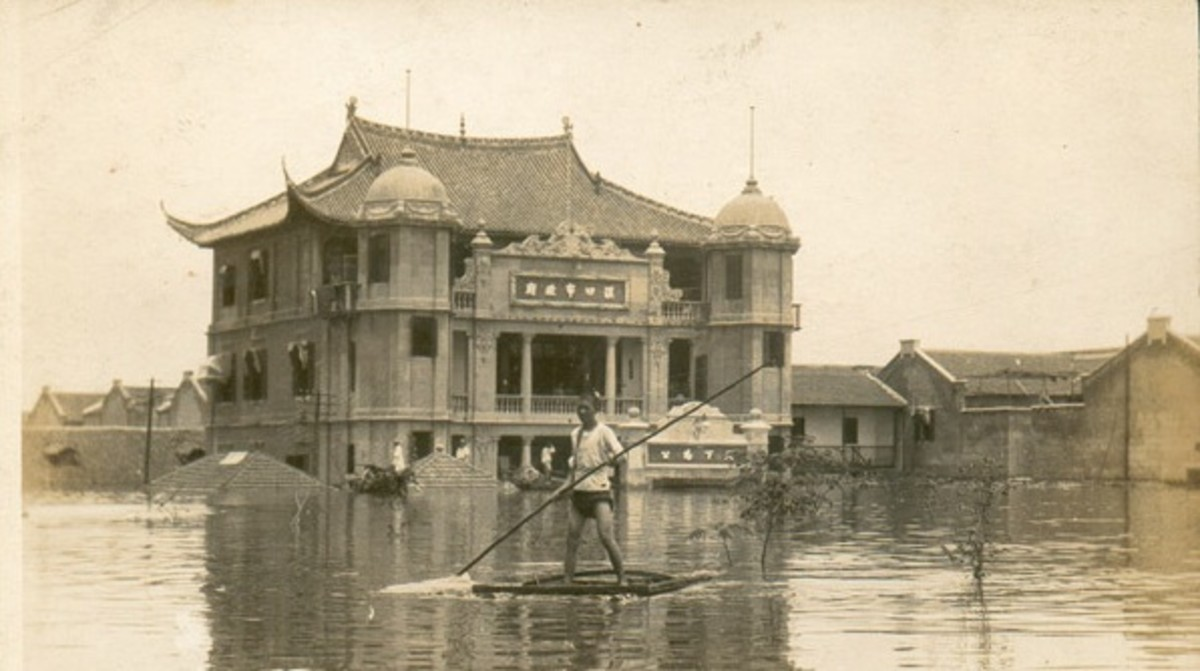 1931 Central China Flood. Notice the government building underwater in the background.