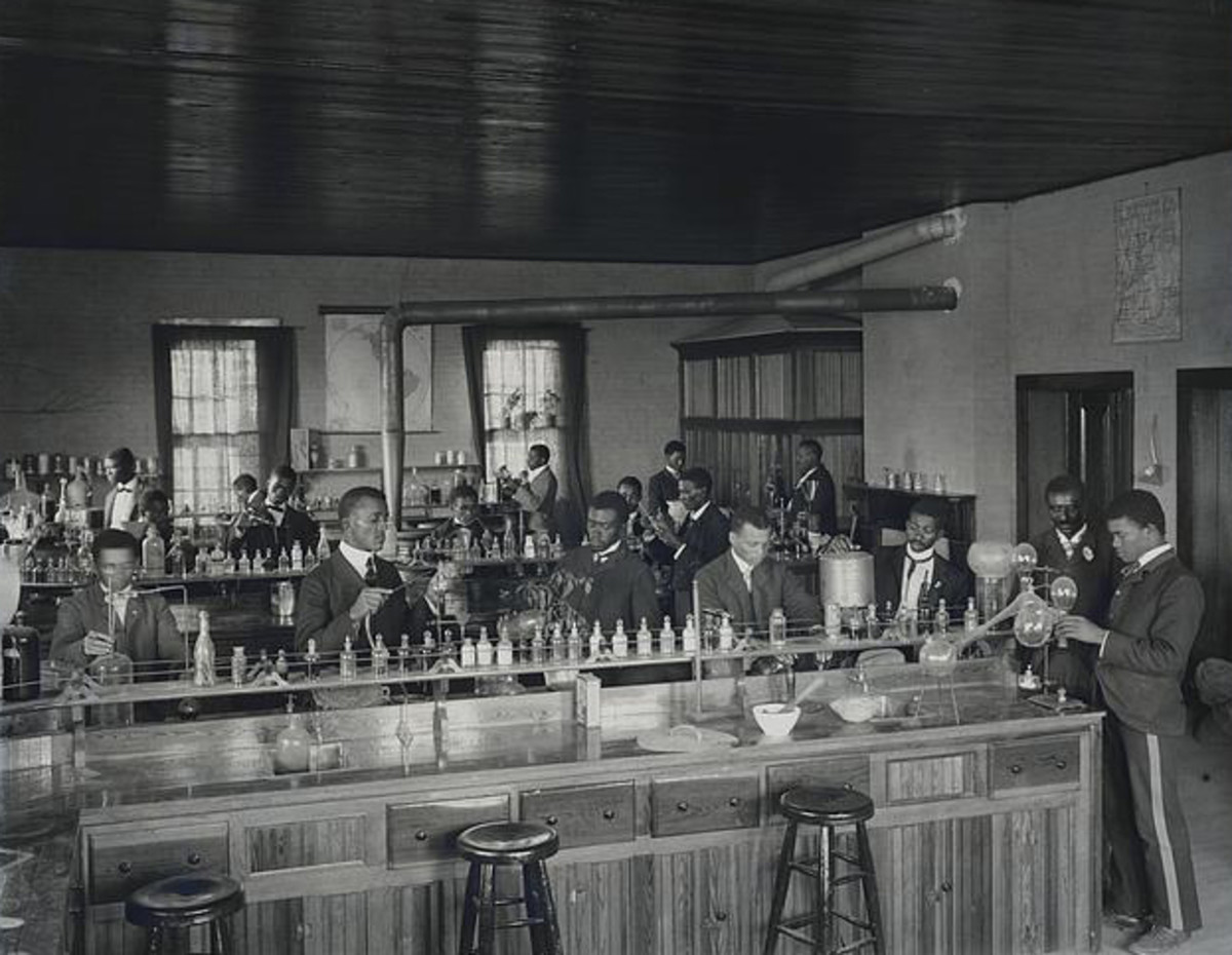 Chemistry laboratory at Tuskegee Institute, circa 1902. Carver stands second from right, facing front.