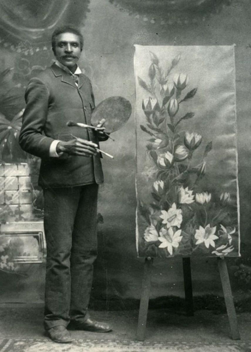 George Washington Carver and his flower art work.