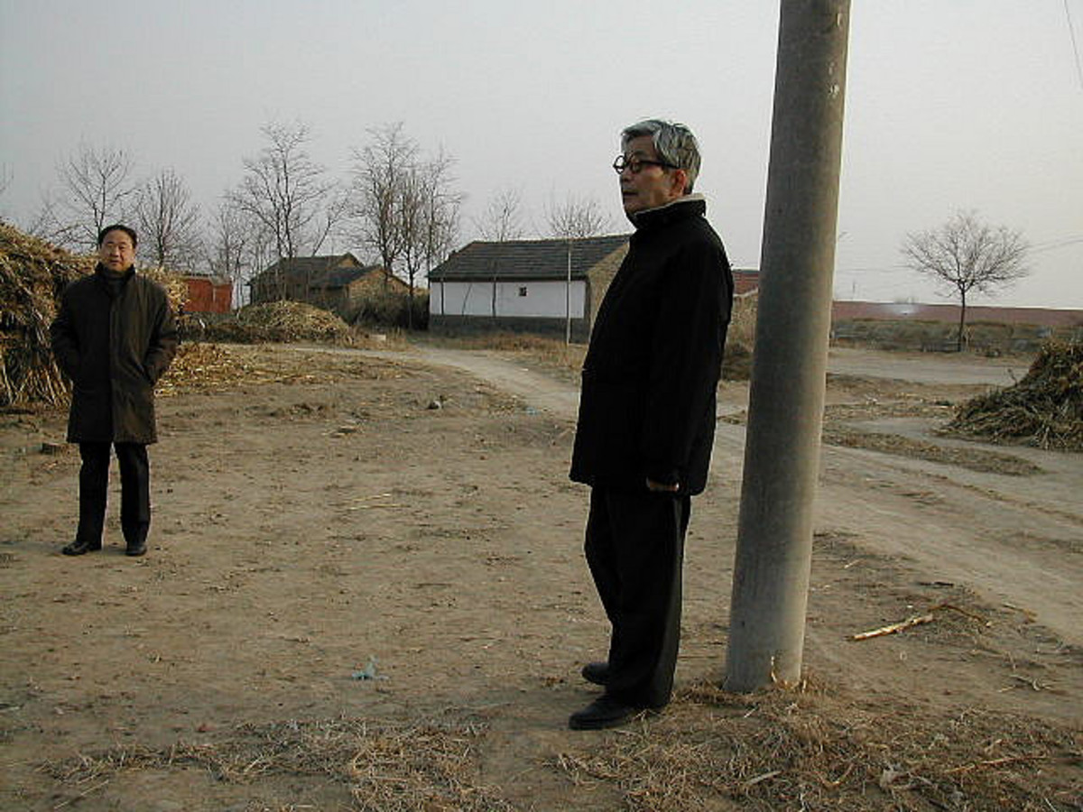 Mo Yan, at left, among the wintry sorghum fields of Shandong that look a lot like Kansas, dreaming up other ¨other concerns¨ for your amusement and edification.