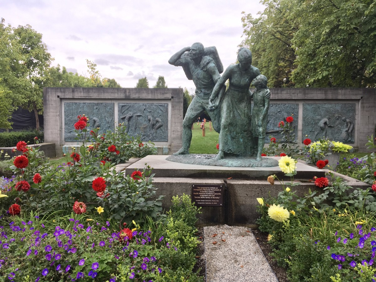 The Immigrant's Memorial Monument by Sergio Comacchio; the main dinosaur exhibit was located on the lawn behind the monument