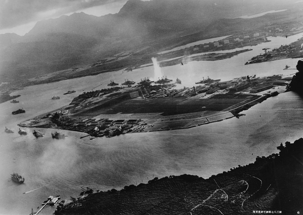 Japanese aerial attack photo. The white plume is a torpedo hit on USS West Virginia.
