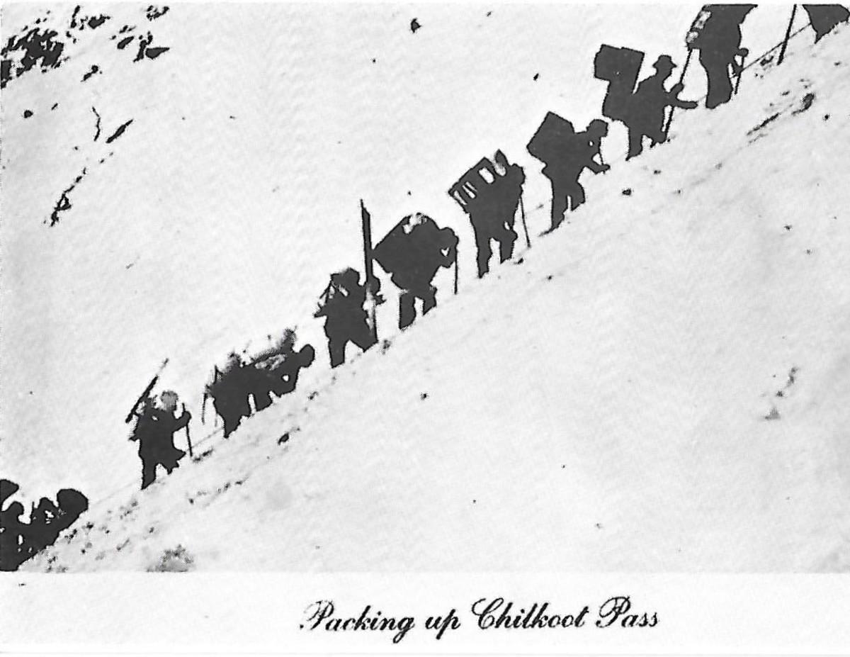 Miners packing supplies up Chilkoot Pass Alaska