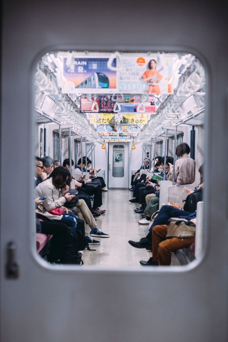 Japan's lonely subway ride. Some people might say this snapshot looks like that of any other subway in the world. The reality is that this exact scene repeats itself millions of times daily. No one talks; not a stare; total respect of others' space.