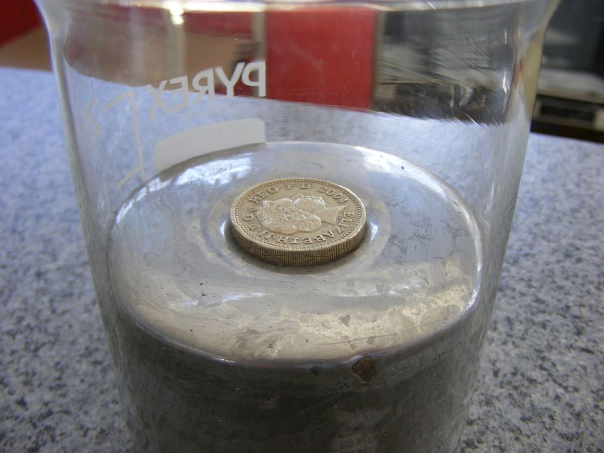 A coin floats in mercury because mercury has a density higher than the density of the metal that the coin is made from.