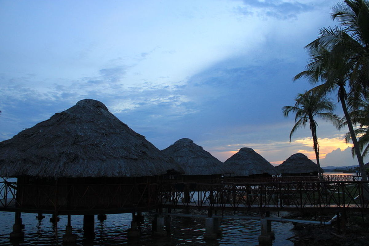 Contemporary traditional Cuna houses in the Guna Yala built on stilts over shallow coastal marshes