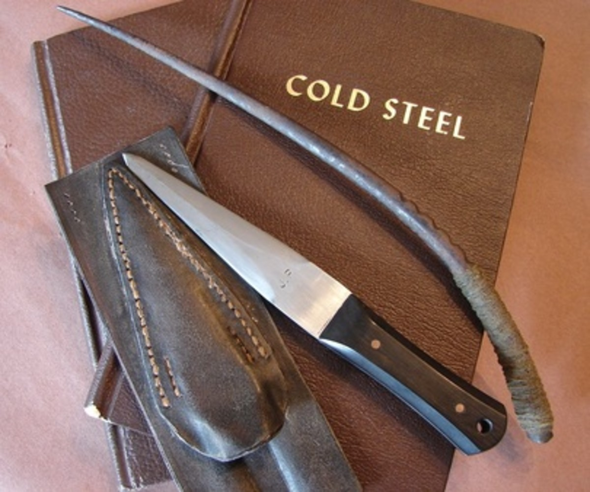 A Tine Dagger (right) side by side with another covert blade (left).