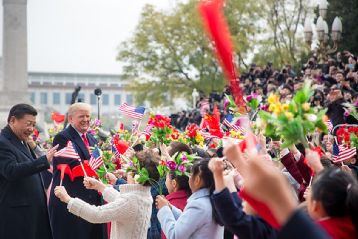 Xi and Trump put on happy faces for the public.