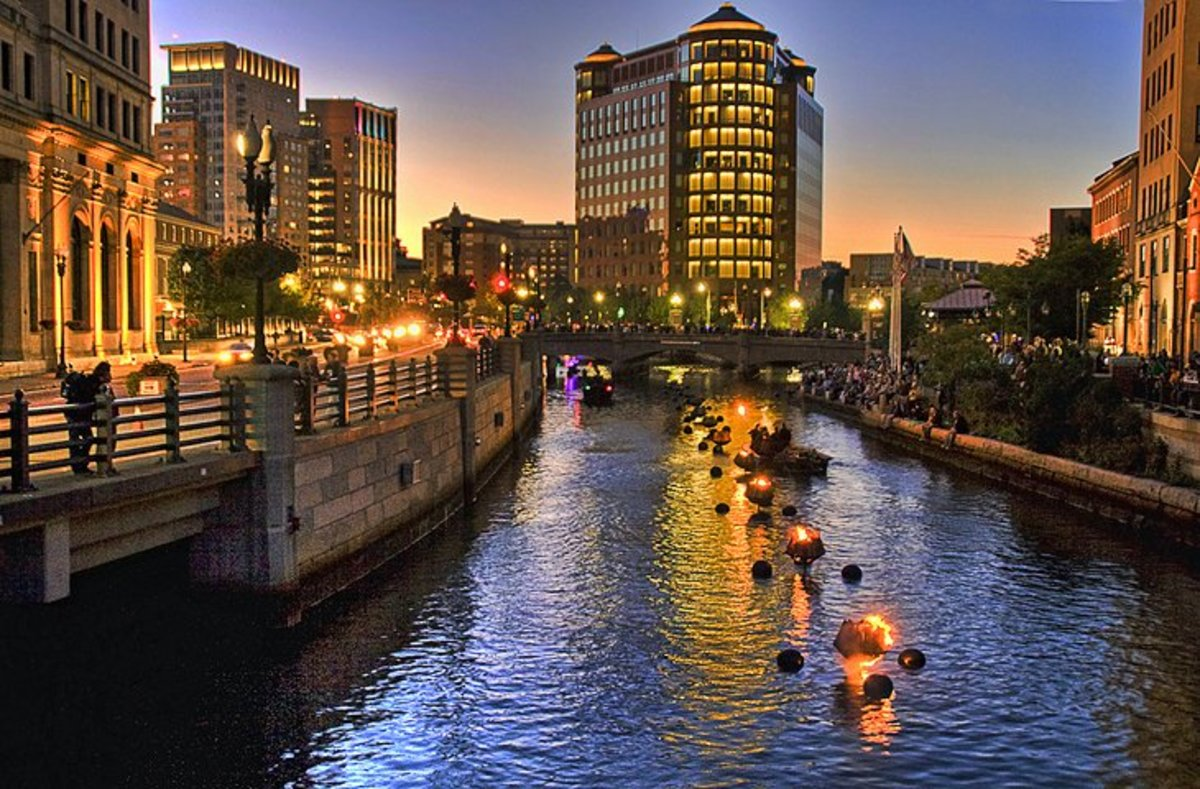 WaterFire Providence: more than 100 bonfires are lit in large iron pans in the river's center and kept blazing throughout the evening as residents and tourists stroll along the brick riverside walkways and footbridges. Photo by liz west via Flickr.