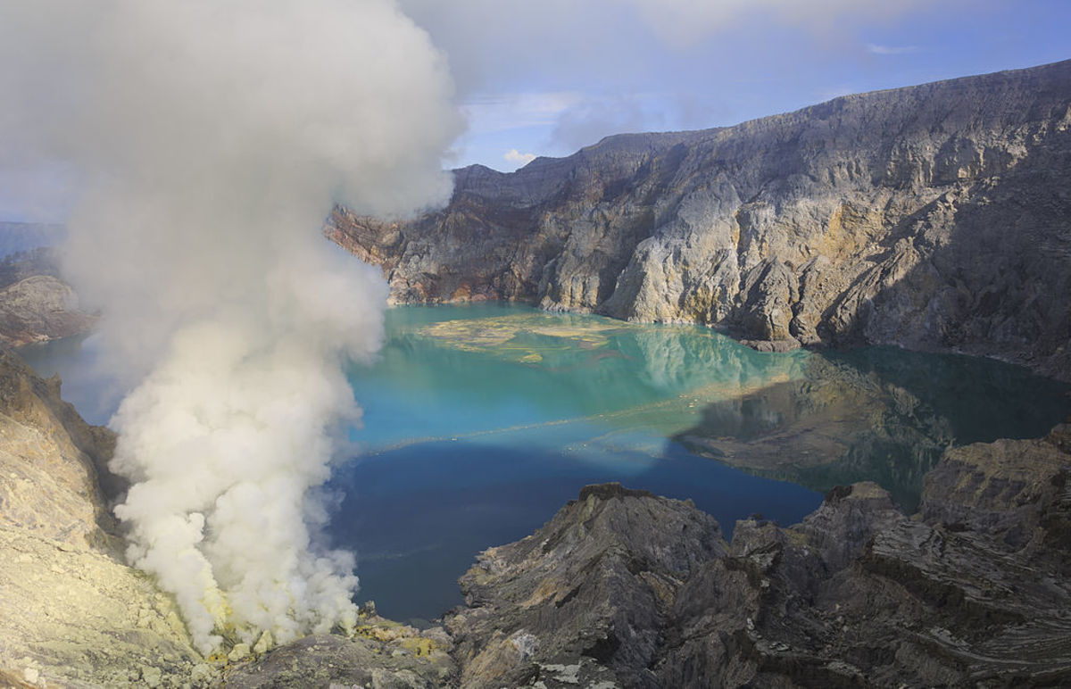 Small volcanic clouds of sulfur gas at the surface can create highly acidic lakes, like the shown here at the Kawah-Ijen volcano in Indonesia..