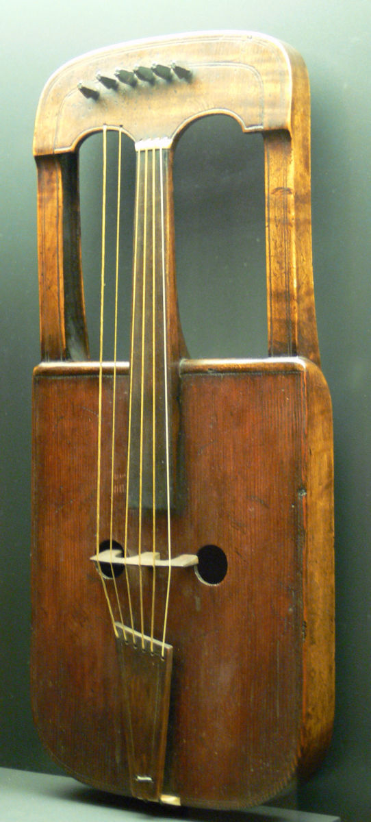 "A ""Crwth"", an archaic instrument of Wales, played by the hand or with a bow."