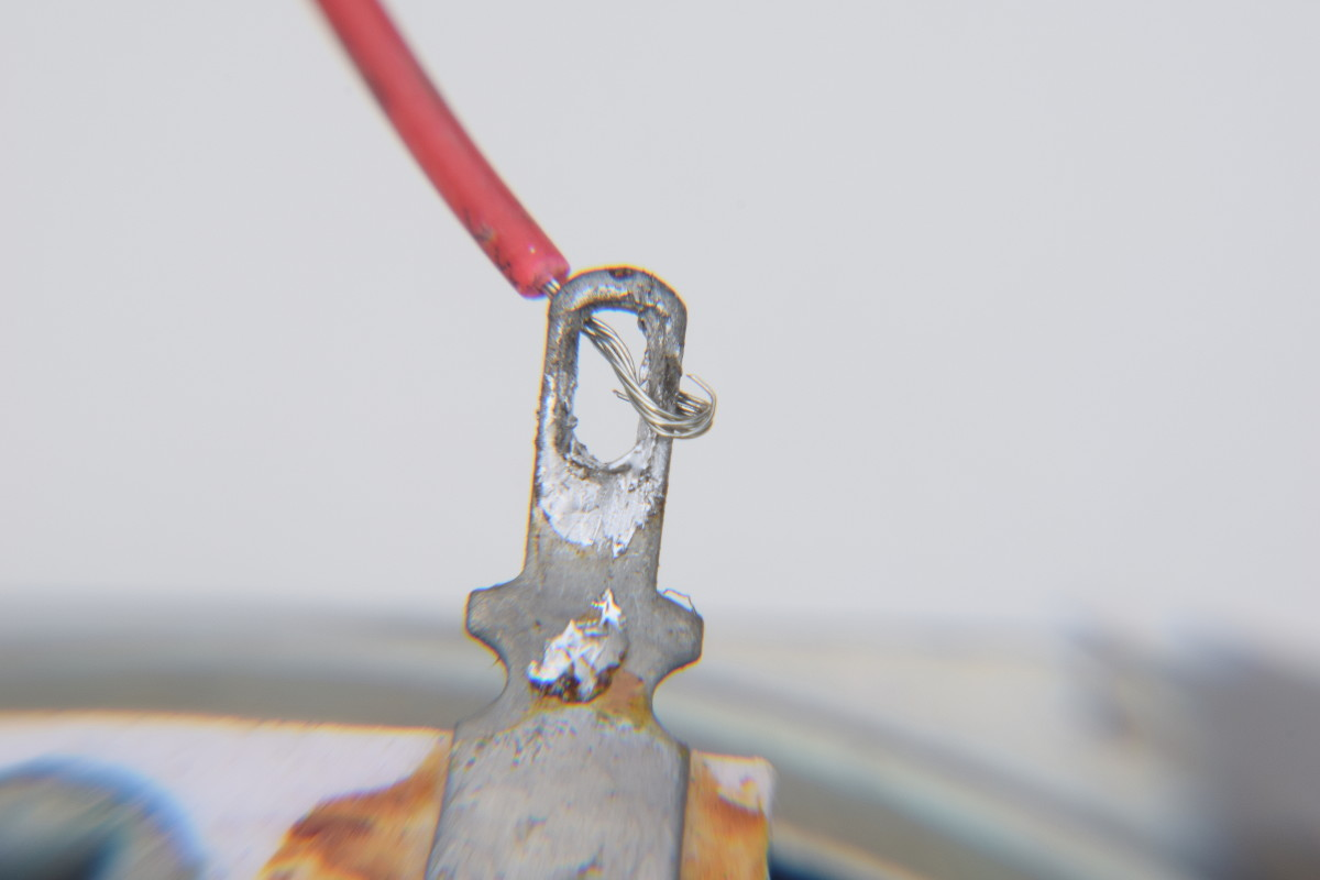Push the wire through the tag and double over to stop it falling out.