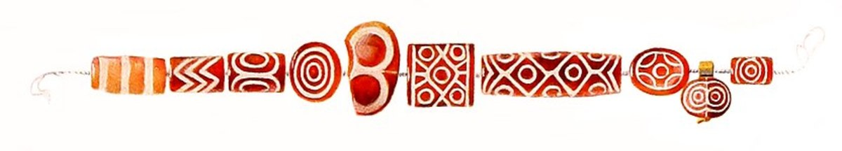 Ancient carnelian beads excavated from the Royal Cemetery of Ur, estimated to be from 2600 - 2500 BCE
