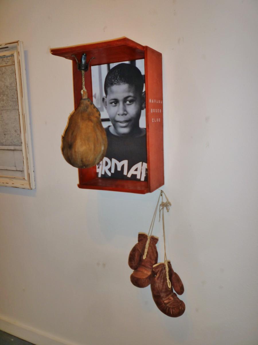 Boxing gloves in Cuba Behind Open Doors by Kevin Douglas West exhibit
