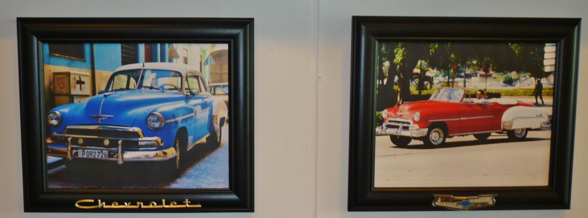 Old cars in Cuba Behind Open Doors exhibit