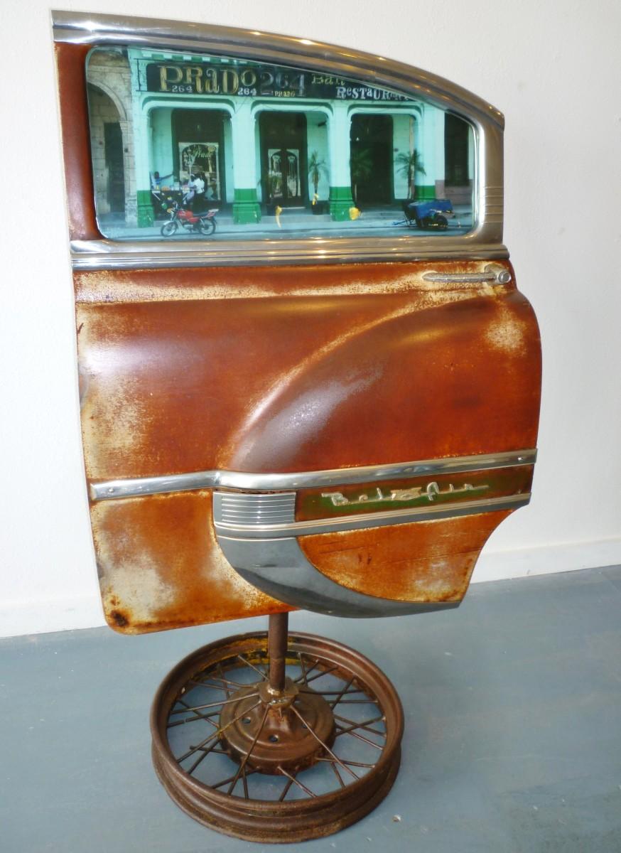 Piece of a car as art in Cuba Behind Open Doors by Kevin Douglas West