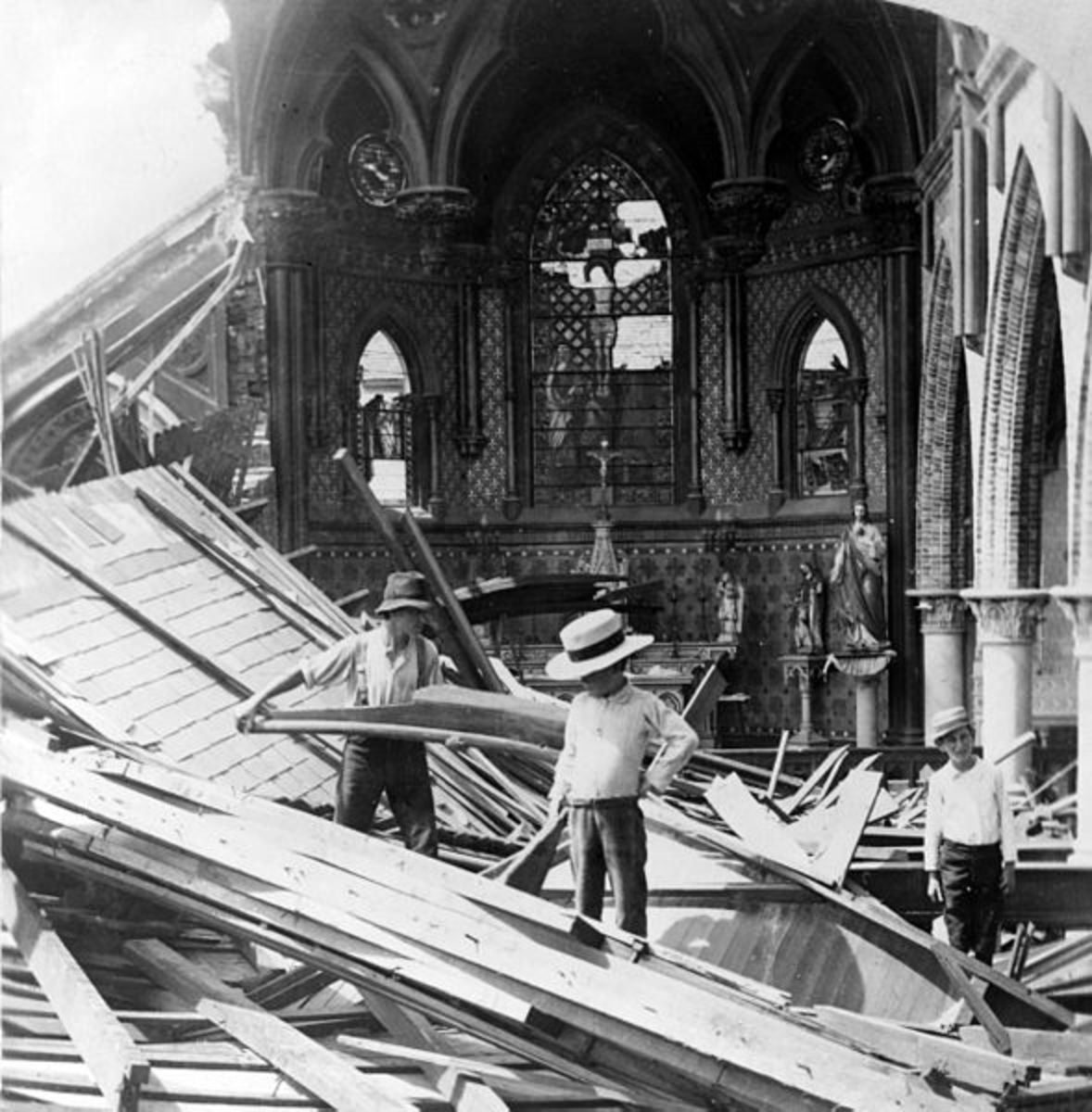 Three young men inside ruins of St. Patrick church, following a violent hurricane in the year 1900 which devastated Galveston and took more than 5,000 lives.