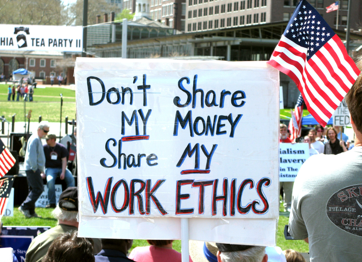 The message on this protest sign seems to  align with Ford's views about work.