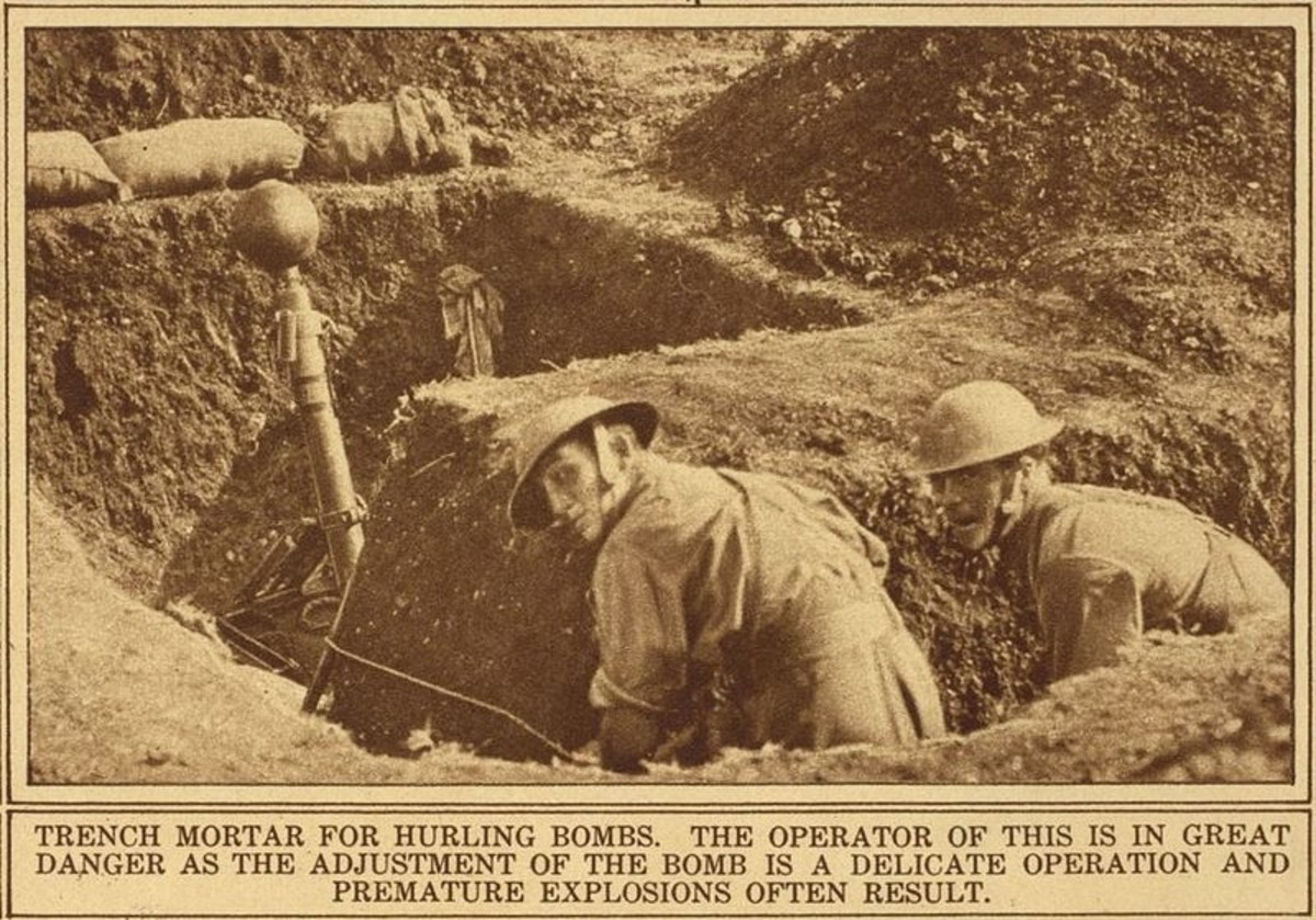Troops about to fire the British 2 inch Medium Mortar from the shelter of a separate trench bay in case of misfire, World War I.