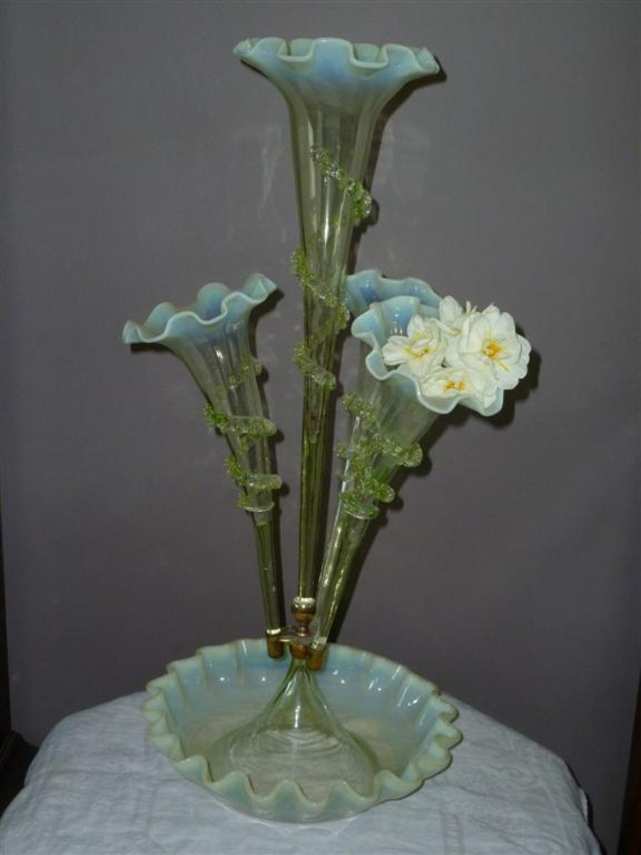 Green vaseline glass epergne with posy.