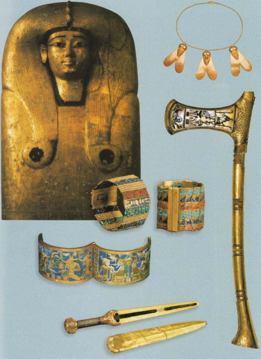 Figure 4: Coffin lid of Queen Ahhotep I along with weapons and small trinkets recovered from the Queen's grave in the Dra Abu el-Naga tomb.