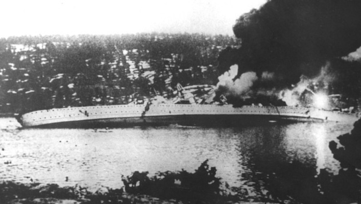 WW2: The German cruiser Blücher listing heavily to port after being hit by cannon fire and torpedoes from the Norwegian coastal fortress Oscarsborg. She sank a short time later.