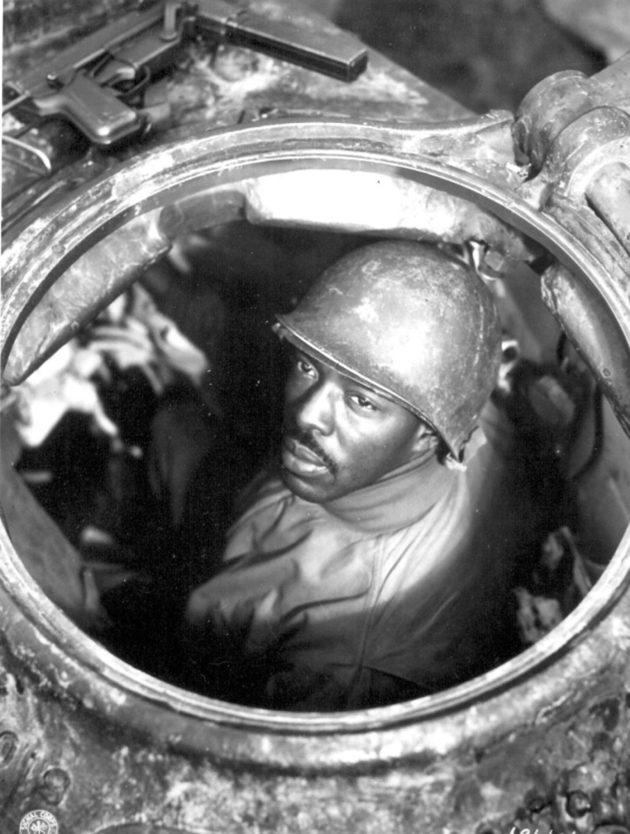 WW2: Cpl. Carlton Chapman is a machine-gunner in an M-4 tank, attached to a Motor Transport unit near Nancy, France. 761st Mt. Bn. November 5, 1944.