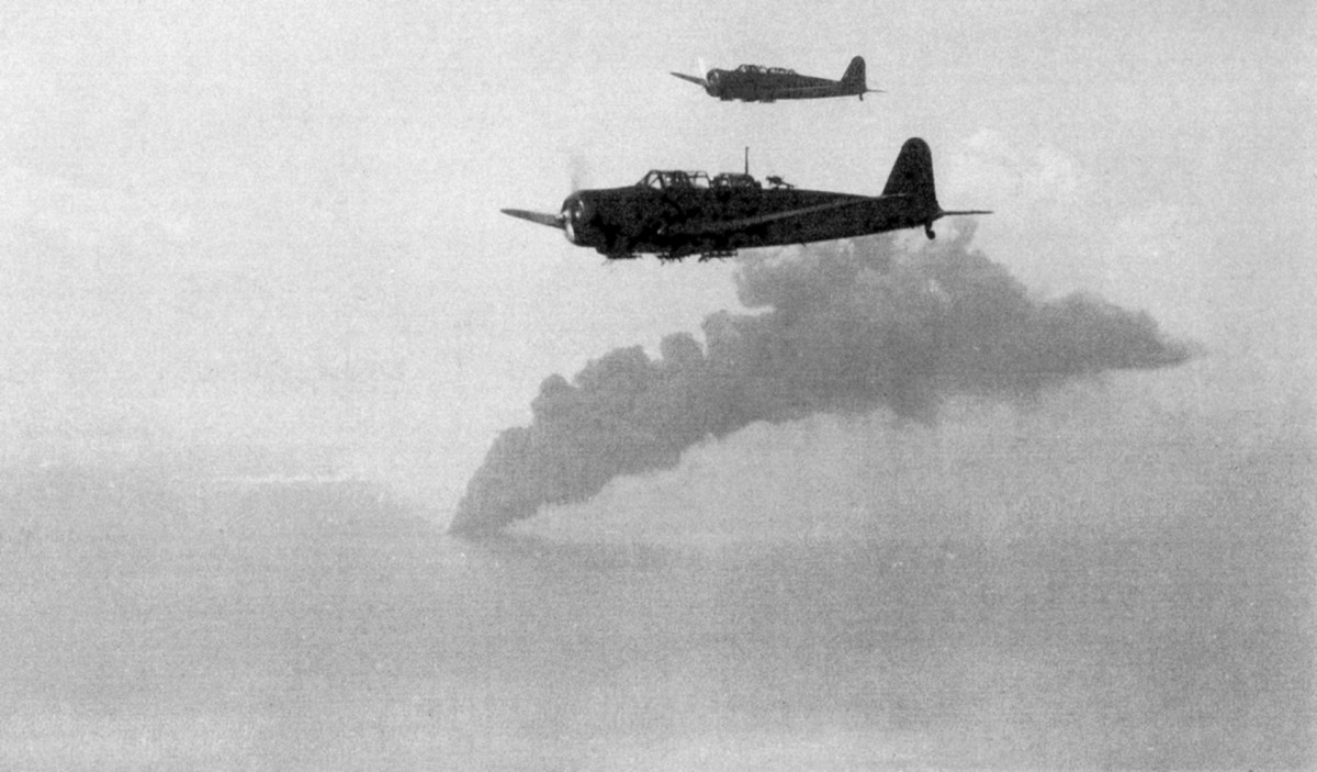The Japanese airplanes are attacking. The smoke comes from one of the Allied ships, that was sinking.