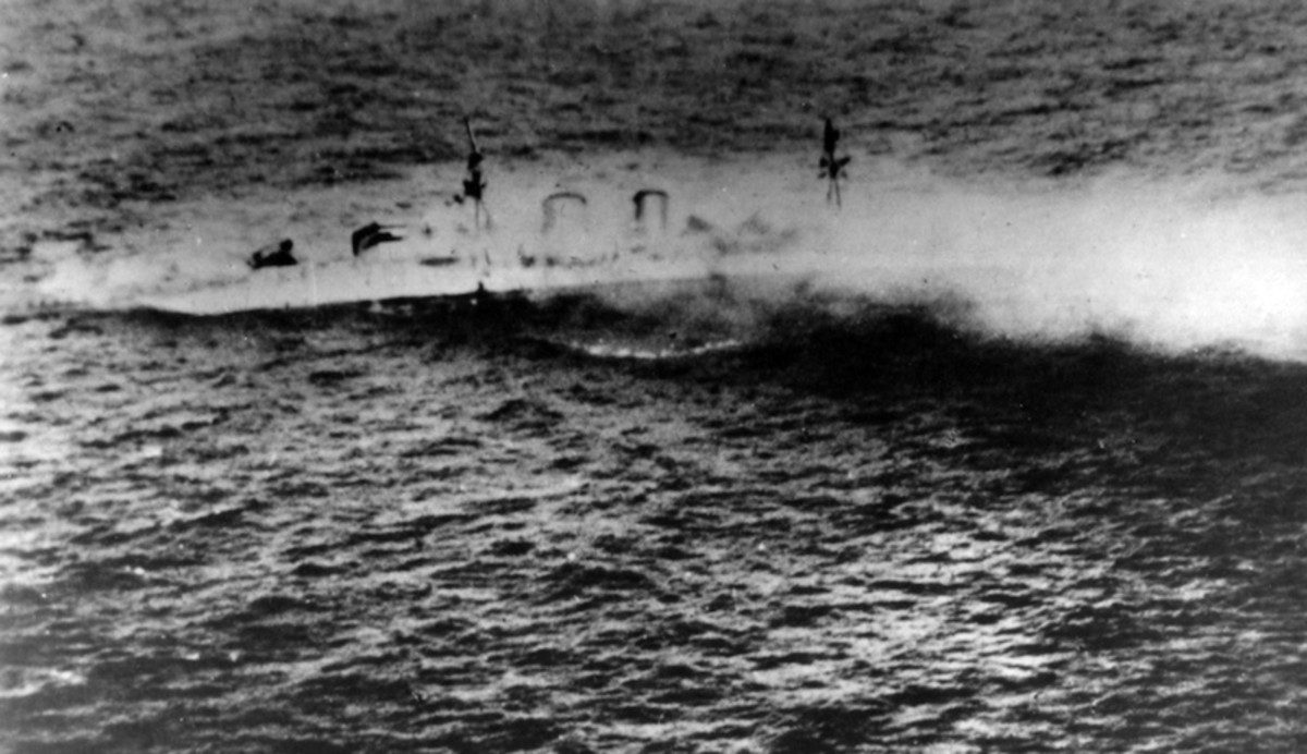 The last moments of a legendary ship: HMS Exeter sinks after scuttling.