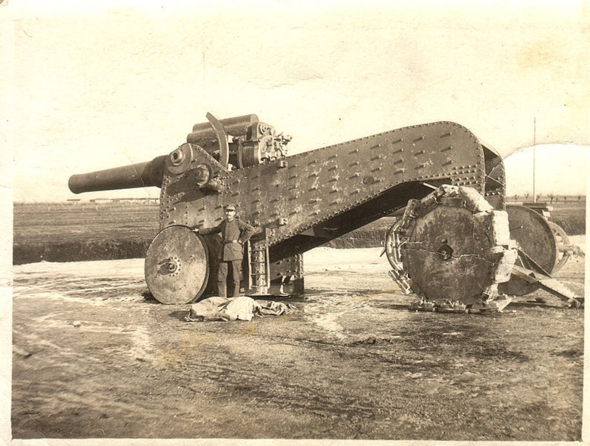 WWI: 305 mm Italian howitzer, captured circa 1917 by German or Austro-Hungarian troops on the Isonzo Front. The gun carriage was known as a De Stefano carriage. Normally it was employed on rails, but pictured here is ad-hoc variant.