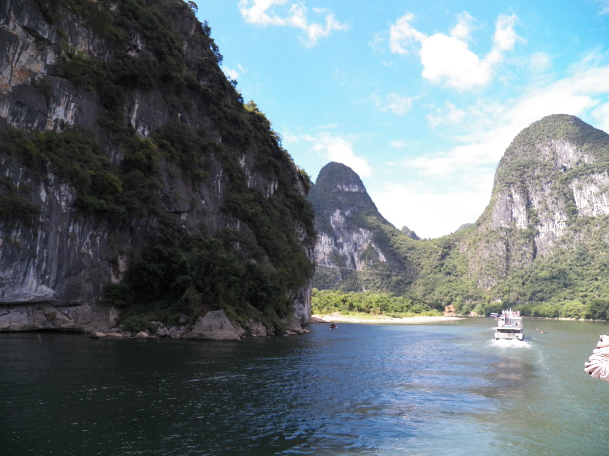 A popular cruise for tourists takes a river boat ride on the Li River, the setting for the book.