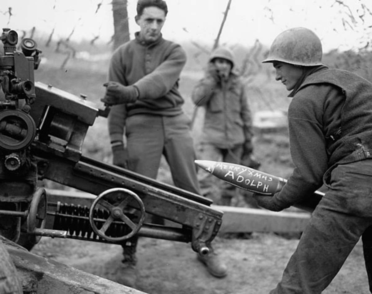 Although a staged photo, it does give a good view of the 105mm. You can see the #1 holding open the breech block, and the wheel that the gunner would use for deflection.  There's also a great shot of the gunner's M12 panoramic scope.