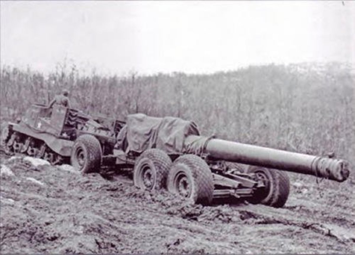 240mm gun being towed by M33 tractor, Italy 1943 or 1944. The barrel was transported separately and then hoisted by crane into the gun carriage once in position.
