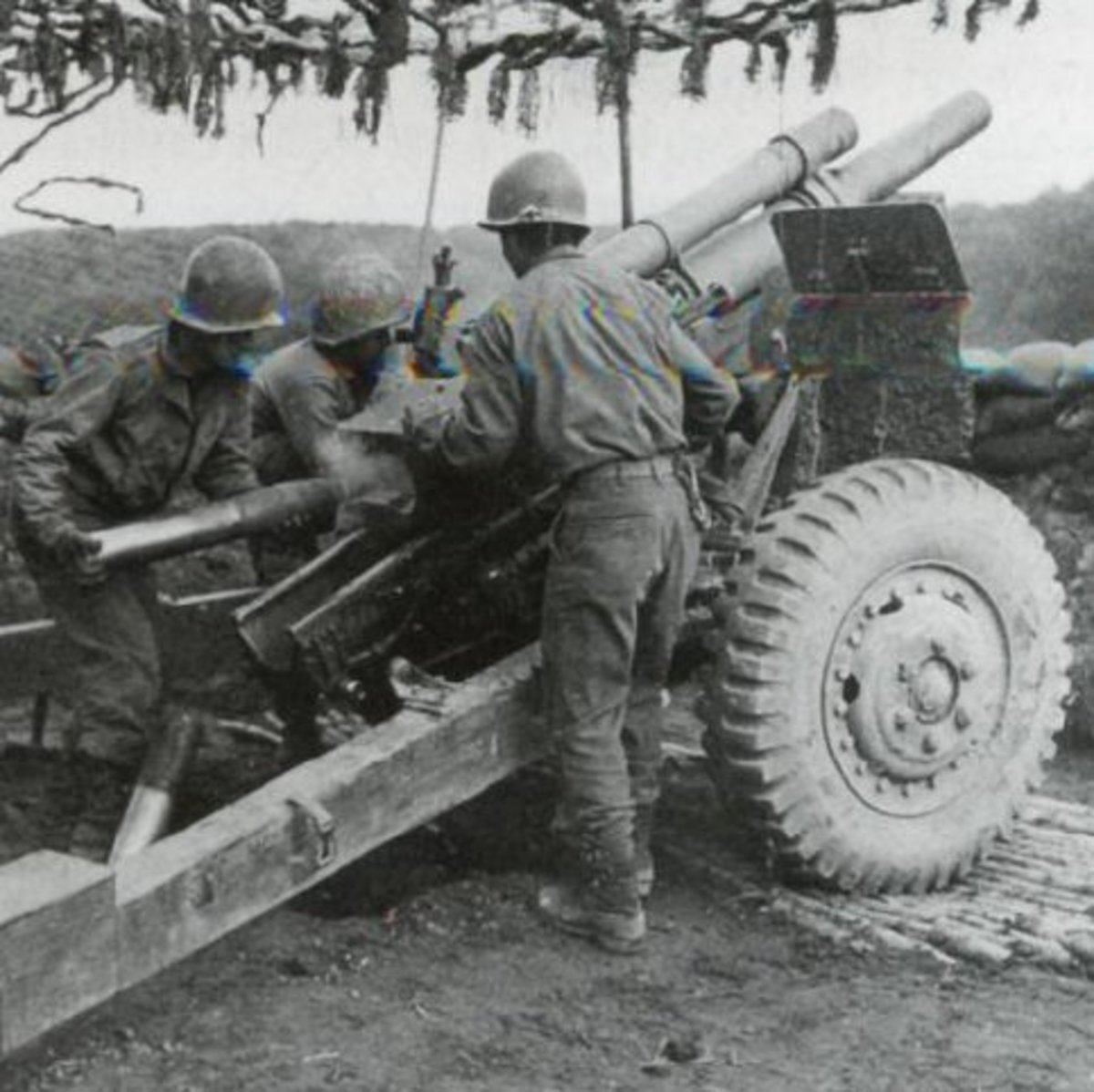 Gun section of the 522nd Field Artillery supporting the famous 442nd Infantry Regiment in 1944.