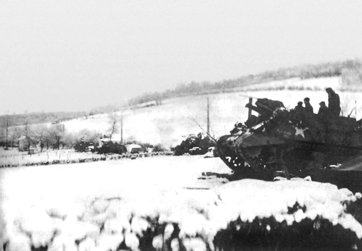"M7 Self-propelled 105mm (""The Priest"")  near La Gleize, Belgium during the Battle of the Bulge"