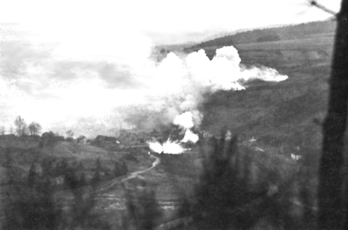 White phosphorus shells fired on German positions during the Bulge.