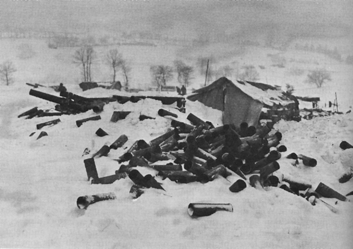 Empty shell casings near gun section, Elsenborn Ridge, 1944.