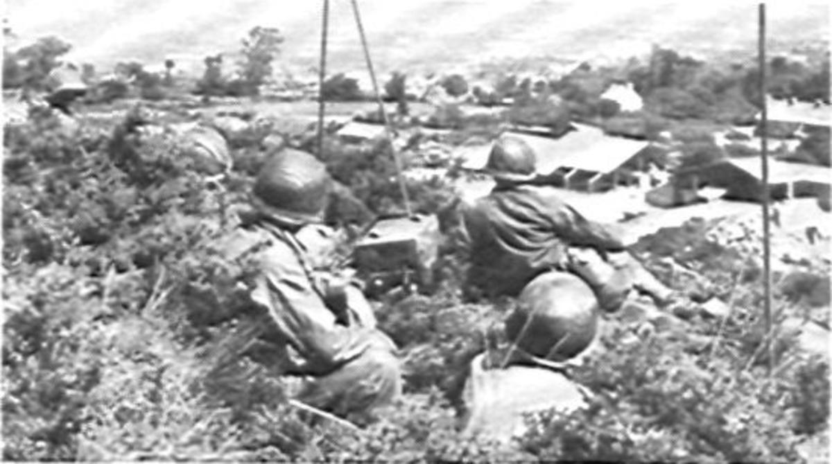 Forward observation team near Cherbourg, France, June 1944.