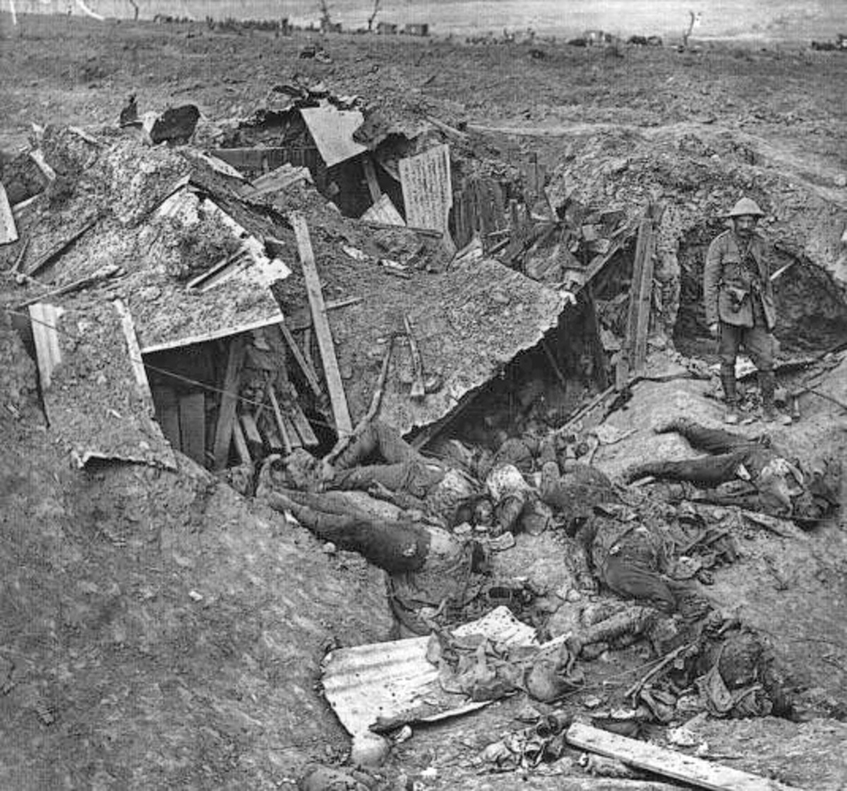 A photo showing a destroyed German trench along with dead troops taken in September 1916.