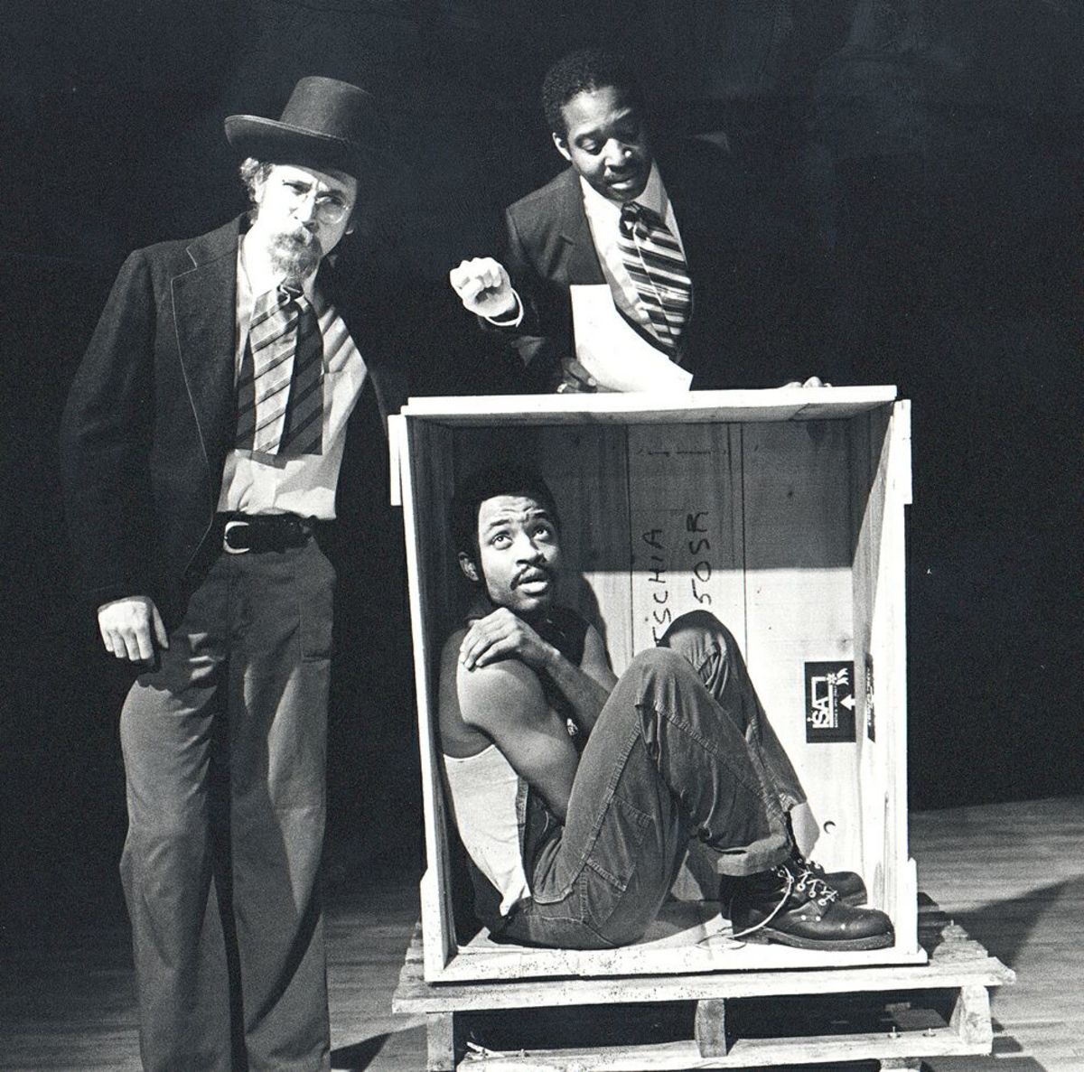Henry in his box as depicted in a one-act play