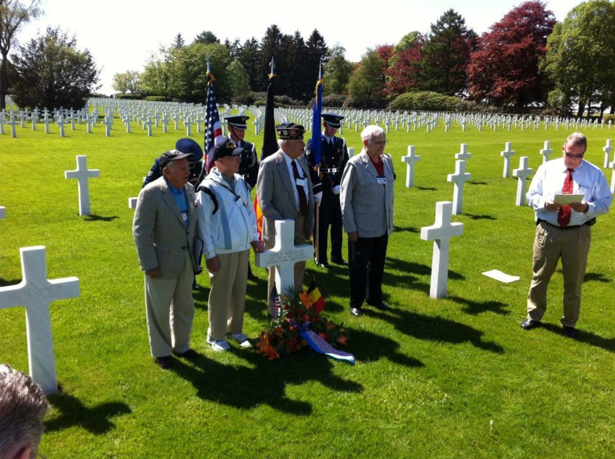 Veterans of the 106th ID along with a German veteran of the battle gather at Wood's grave for a ceremony in 2012.  John Gatens is second from left.
