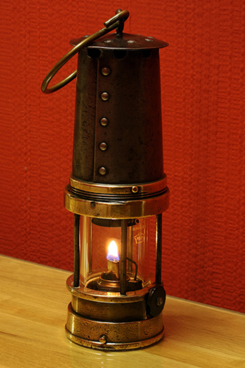 A Davy Lamp, invented by Sir Humphrey Davy who was president of the Royal Institution and became Michael Faraday's mentor.