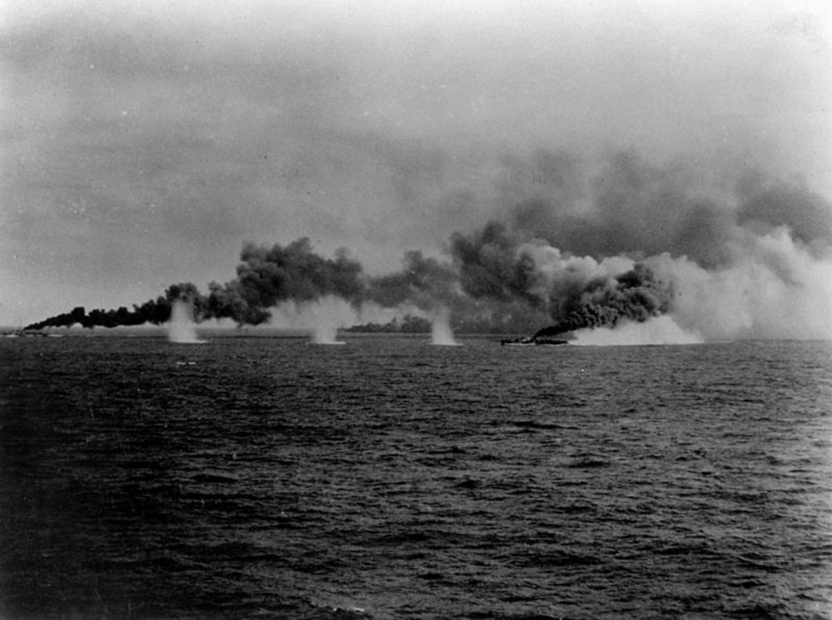 WW2: U.S. destroyers and destroyer escorts laying a smoke screen during the Battle of Samar, 25 October 1944. Note the splashes from Japanese shells.