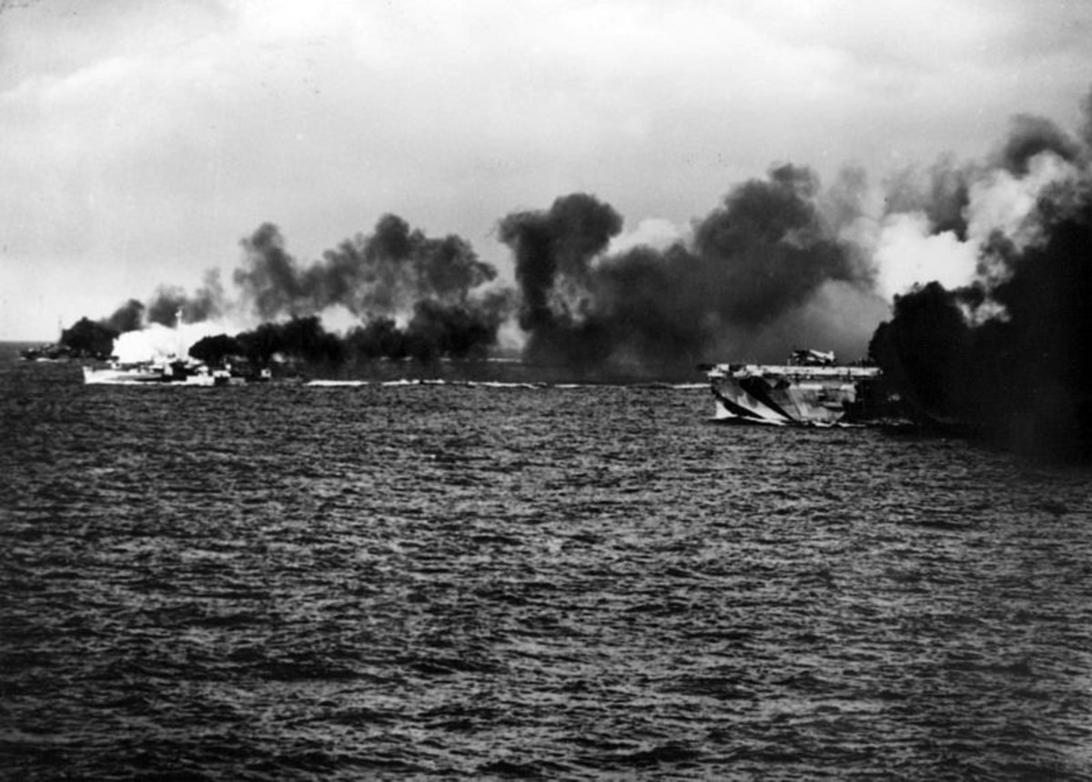 World War II: Escort carrier Gambier Bay and her escorts laying a smoke screen early in the battle.