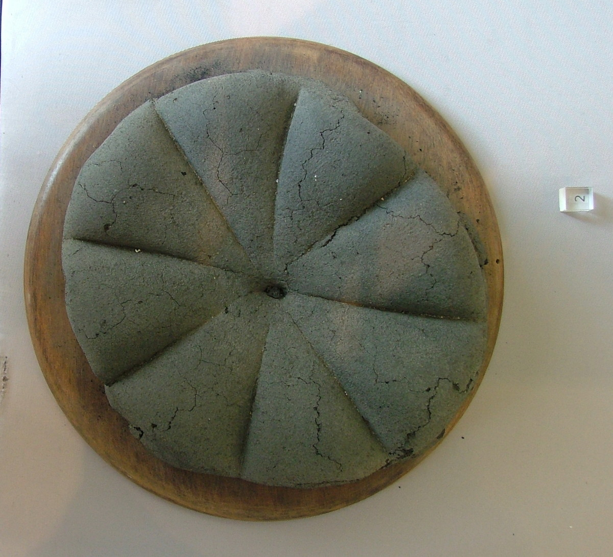 A preserved loaf of bread recovered from the archaeological site of Pompeii.