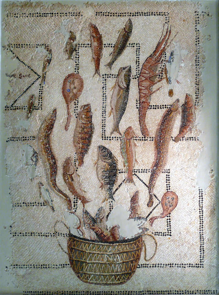 A Roman mosaic of various types of seafood in a basket.