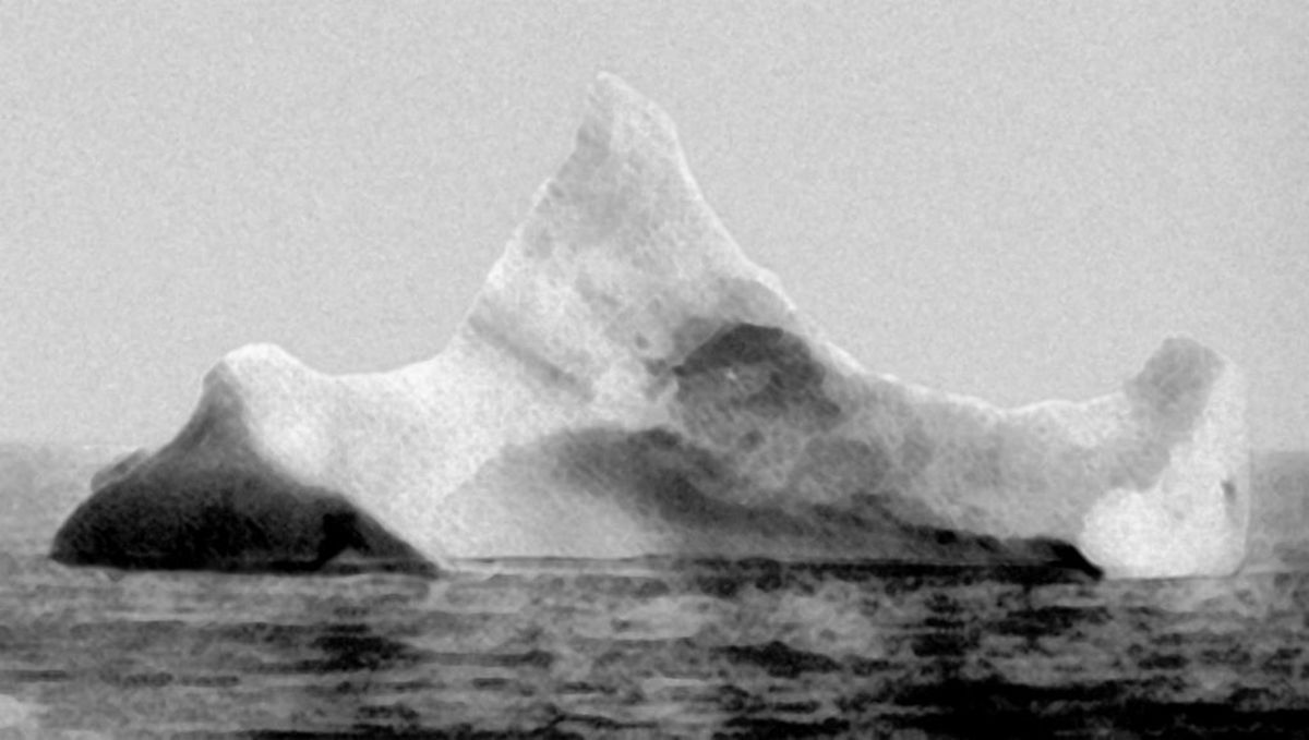 A photograph from the morning of 15 April 1912, showing the iceberg that it is thought that Titanic hit. The hull was not punctured by the iceberg, but dented badly enough to damage the seams and let water seep in. The ship then went down bow first.