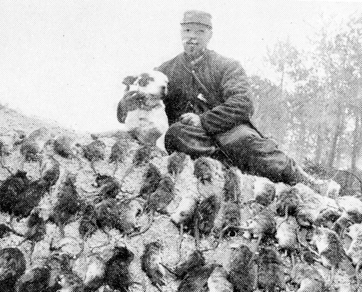 The war on the trench pest. Rat-hunter with a bag of rodents killed by the dog. These vermin infested some of the first-line positions in swarms, and were a source of great annoyance to the soldiers.