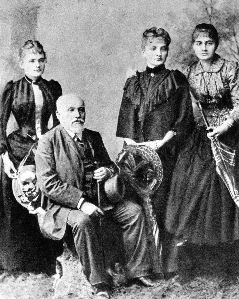 Maria Curie (far left) with her father and two surviving sisters as of 1890.