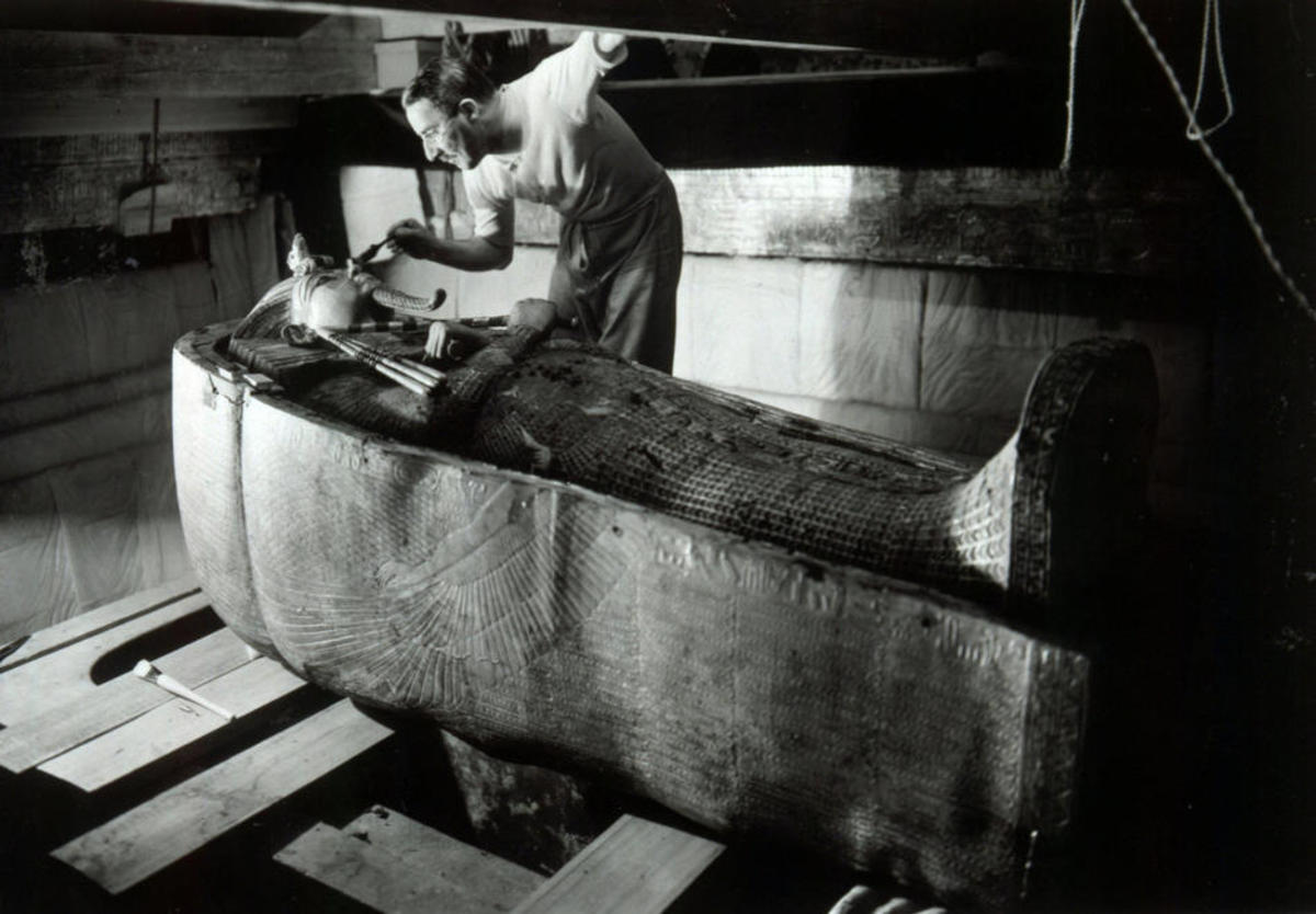 Howard Carter examing King Tut